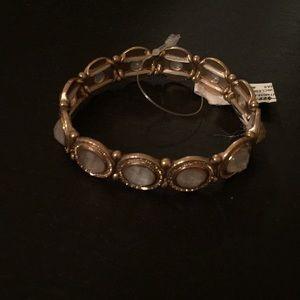 Gold and white bracelet